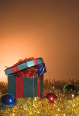 A set of Christmas gifts inside a large wrapped box.