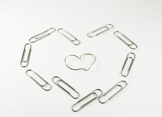 curved paper-clips made into heart