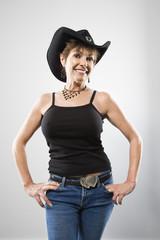 Portrait of pretty Caucasian woman in western wear smiling.