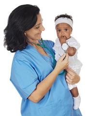 nurse with stethoscope holding baby over white background