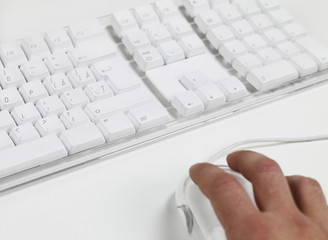 Man working on computer keyboard