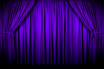 Wall Mural - Large purple curtain with spot light and fading into dark.