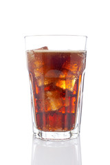 A soda drink glass with ice cubes, reflected on white background