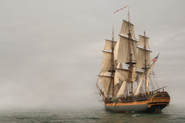 Wall Mural - Vintage Frigate sailing into a fog bank