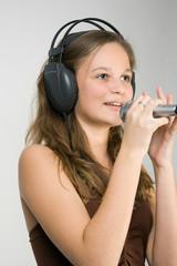 Young pretty girl singing karaoke