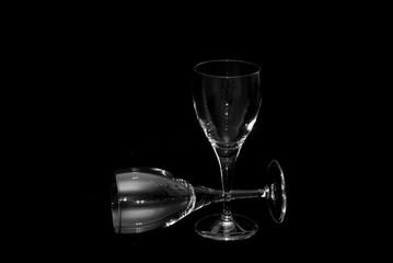 thin wine glasses againt a black background