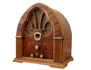 Old Wooden radio at slight angle with white background.