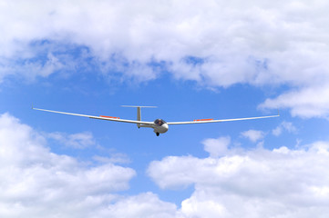 Modern glider in flight coming into land.