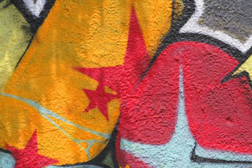 Colorful graffiti with shadows-detail on a wall.