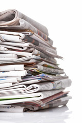 Big stack of newspaper on white background