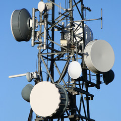 Microwave dishes on communication tower