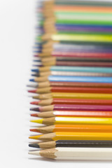 colorful pencils on white background in horizontal position