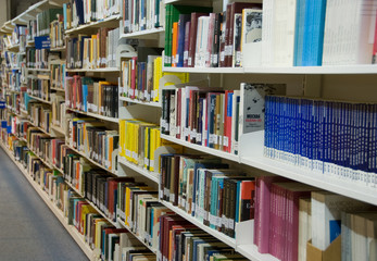 A lot of books on the book shelfs in the library