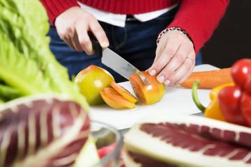 home life: woman preparing something to eat