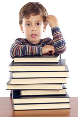 Adorable child studying a over white background