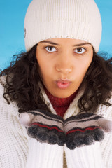 beautiful winter girl isolated on blue background