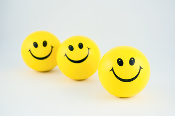 smiley balls in a row