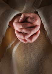 The hands of Jesus in clasped in prayer