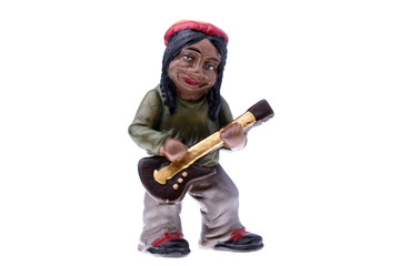 Rastaman statuette playing bass