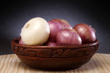 Onions in wooden bowl