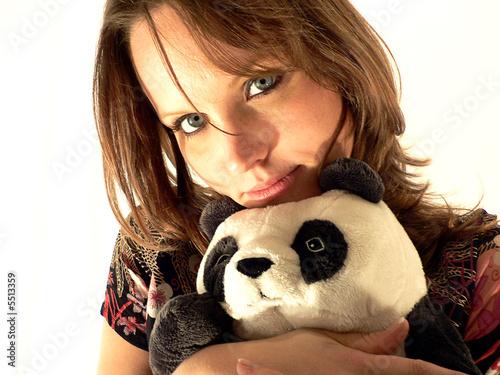 jeune femme sexy avec un panda en peluche photo libre de droits sur la banque d 39 images fotolia. Black Bedroom Furniture Sets. Home Design Ideas