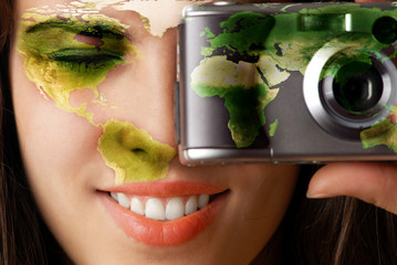 Model with global map on her face making a photo