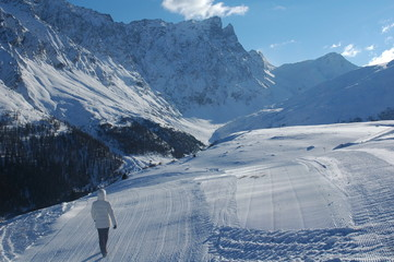panorama of snowy mountains in the sunny swiss alps