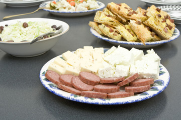 plates with freshly cooked food placed on a table