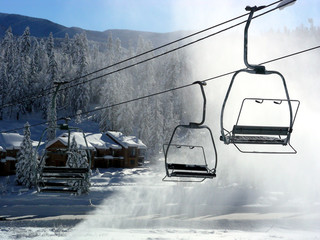 Ski lifts operating amid the windblown snow