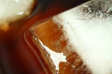 ice cubes soaked in cold whisky drink