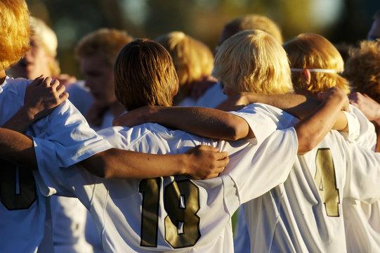 High school occer team huddle