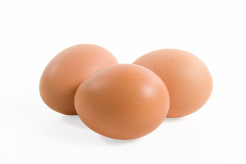 Three eggs isolated on a white background.