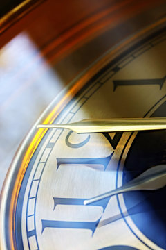 Clock set to the eleventh hour.  Angled sunlight.