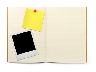 lined exercise book with photo frame and yellow note,