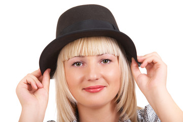 Portrait of blonde girl in black hat on the white background
