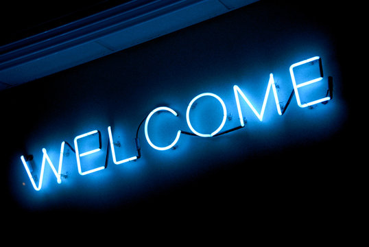 """neon """"welcome"""" sign"""