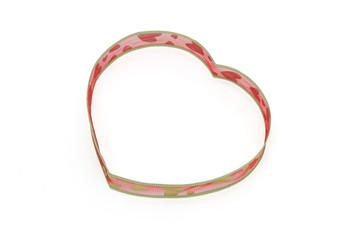 Heart shaped ribbon on white background
