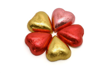 Heart shaped chocolates arranged in floral pattern