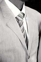 male torso in formal suite