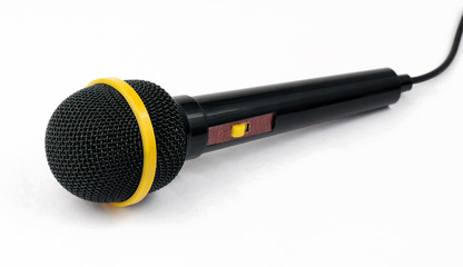 Black microphone for singing isolated on white background..