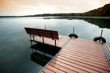 Twilight landscape with dock on small lake