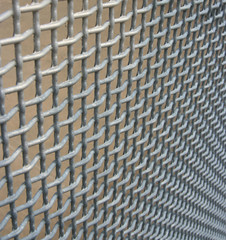 Wire mesh fencing material vanishing into the corner