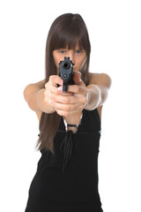 Beautiful girl holding a handgun, focus on gun.