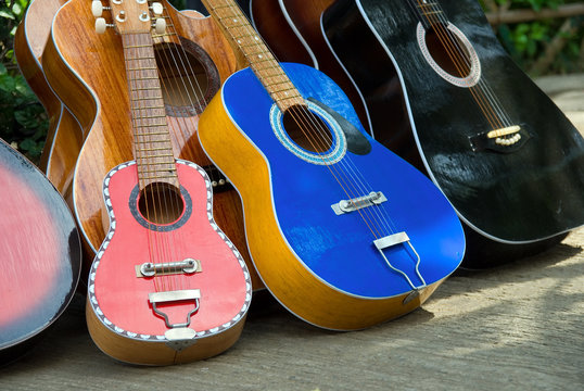 A series of handmade guitars downtown on a street sale.