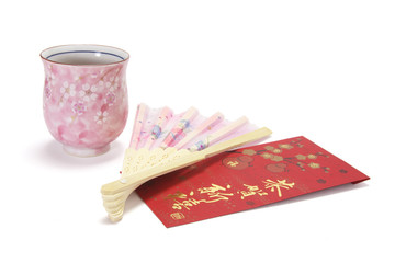 Cup of Chinese Tea with Chinese Fan and Red Packet