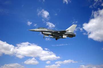 warplane is flying in blu and cloudy sky