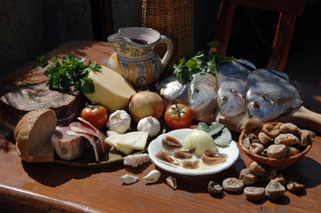 Still life with dried figs, fresh fish, cheese, bread