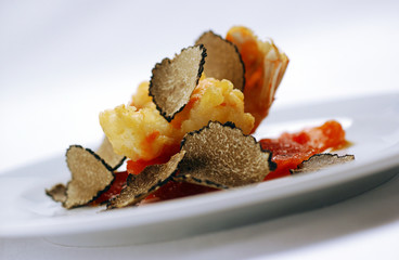 Shrimp tail on tomato slice with truffles