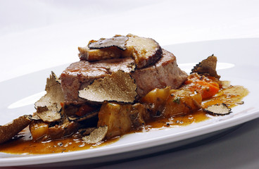 Veal steak with potatoes, tomatoes and truffle sauce