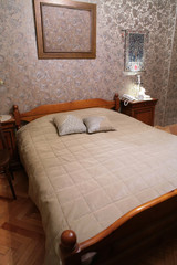 comfortable bedroom with wooden old-time bed, vintage